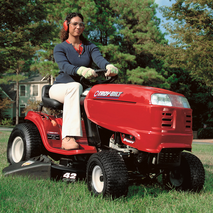 woman on ridding mower