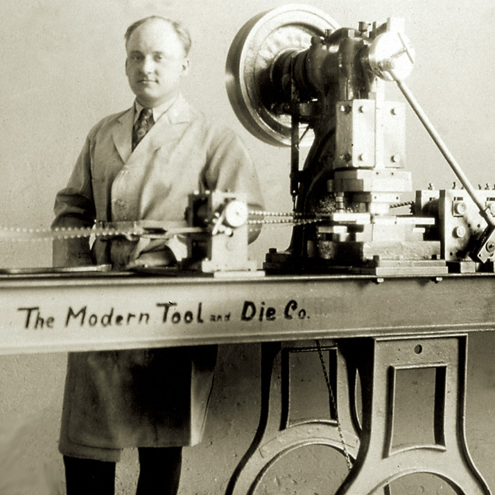 man in front of die machine